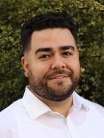 Headshot of Cesar De La Vega, JD