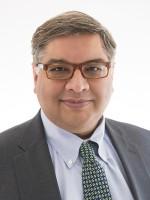 Headshot of Adolph P. Falcón, MPP